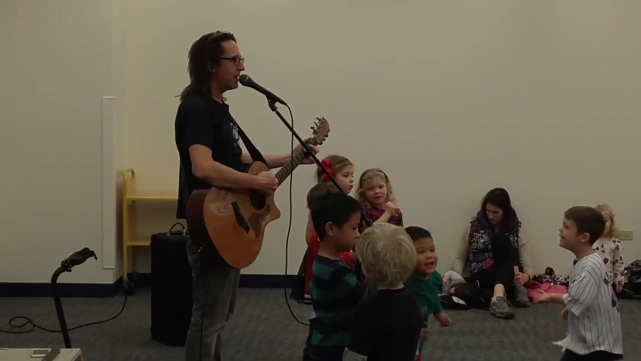 Glen Ellyn native Ralph Covert performs at the Wheaton Public Library on Dec. 19 as part of his Ralph's World children's music project.