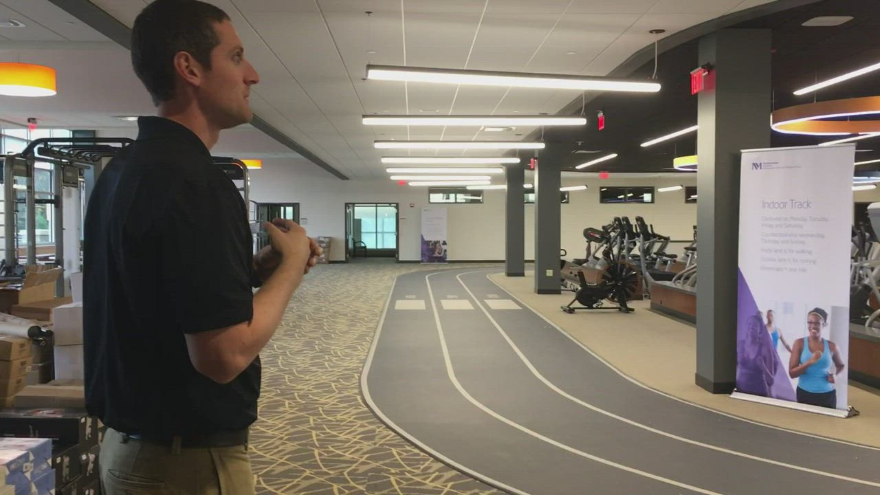 Officials from the Northwestern Medicine Kishwaukee Hospital campus lead a tour Friday of the new Health and Wellness Center, which also includes a fitness area.