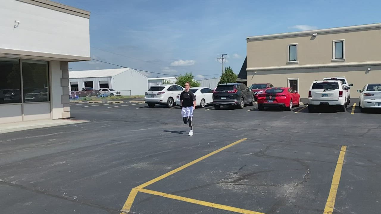 Landis Sims, 14, tries out his new running legs in the parking lot of David Rotter Prosthetics in Joliet. Video courtesy of David Rotter.