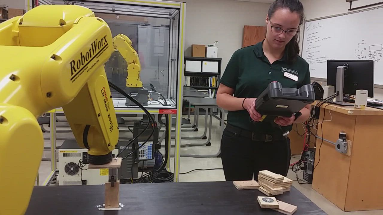 Student worker Alea Akers demonstrates the new robot at Kishwaukee College – Rachel, as she and her fellow student workers have named her.