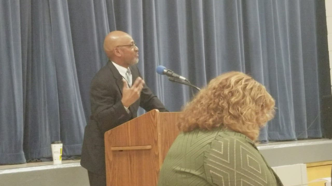 "Larry Crawford, truancy specialist for Joliet Public Schools District 86, delivers the invocation before the lunch during the district's ""Principal for a Day"" program."