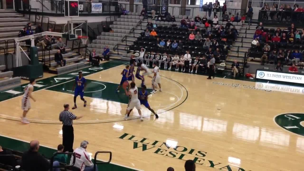 After more than a minute long possession, Johnny Fuller gets a steal and layup.