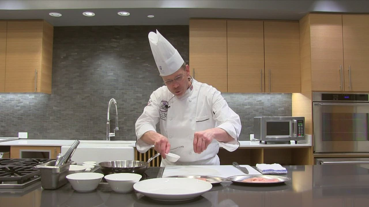 "Joliet Junior College chef instructor Timothy Bucci shows how to make sautéed chicken medallions with an herbed wine sauce in episode two of ""Whisking It Up."""