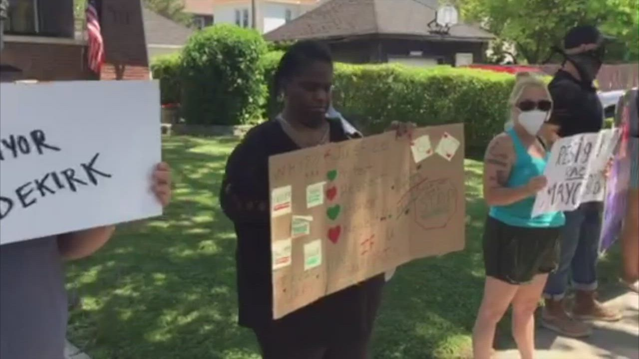 Protests continue outside Joliet Mayor Bob O'Dekirk's home on Sunday in Joliet.