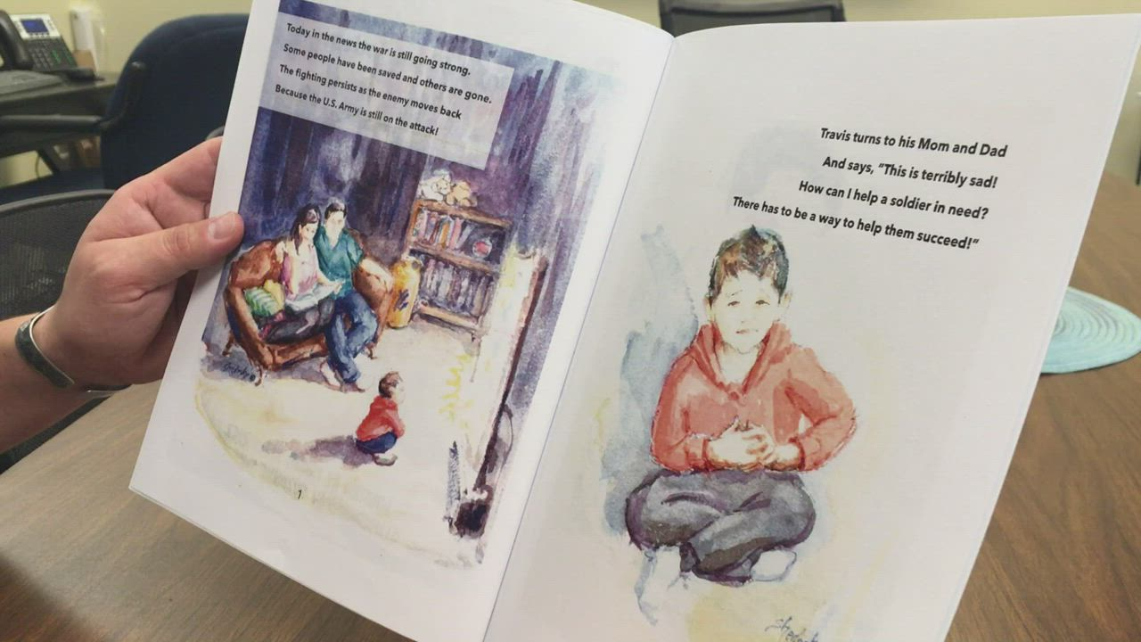 """Travis Velazquez reads a few pages out of his children's book """"Protected by the Best,"""" which is about a boy who is guided by his military veteran father on how he can best help U.S. troops."""