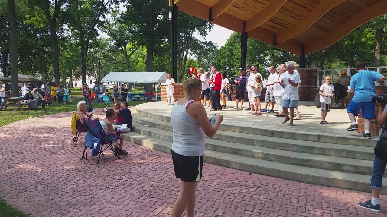 "Streator residents sing the theme to ""Mister Rogers Neighborhood"" during the Won't You Be My Neighbor picnic"