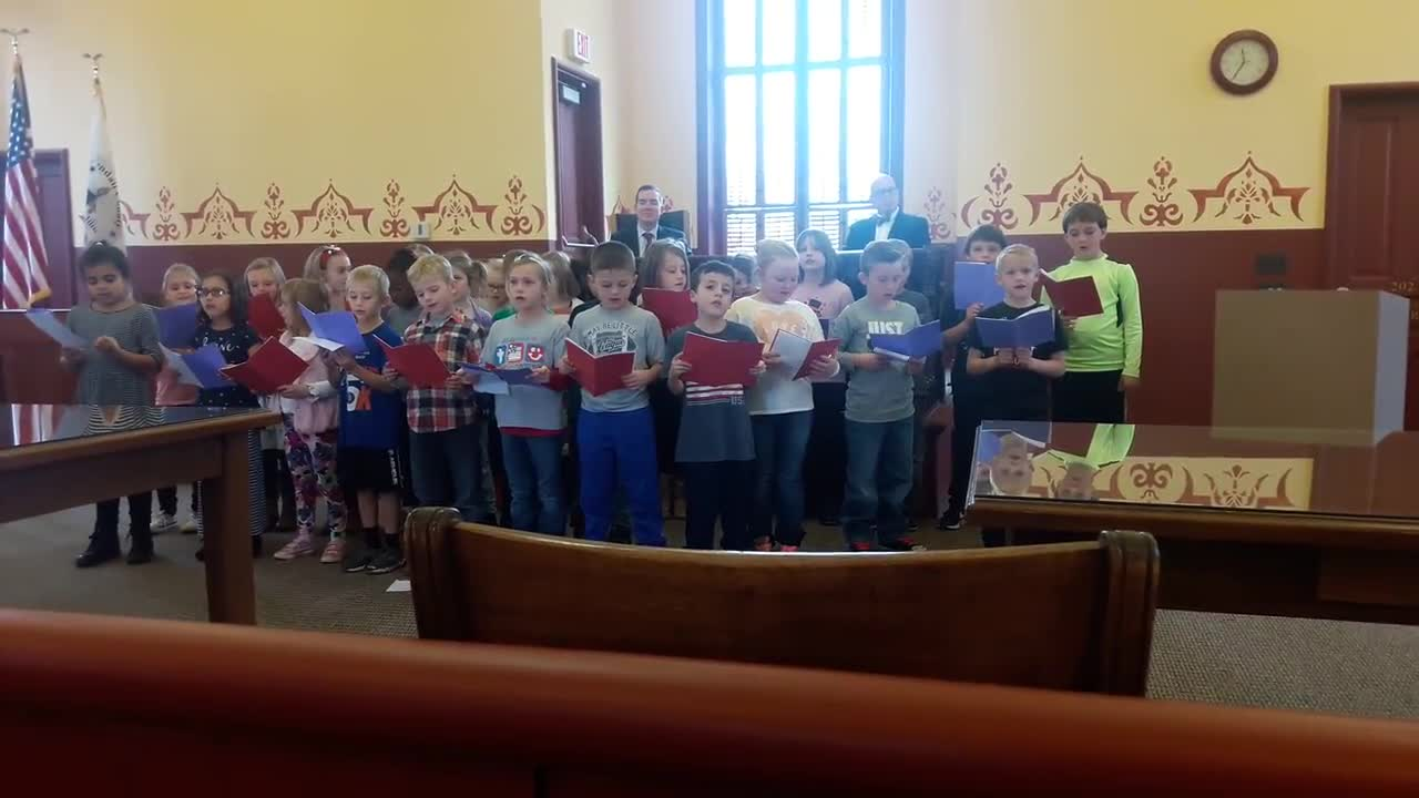 "Second grade students from Cross Lutheran School in Yorkville sang patriotic songs, including Woody Guthrie's ""This Land is Your Land,"" during a bicentennial state flag raising ceremony at the Kendall County Historic Courthouse in Yorkville on Dec. 4."