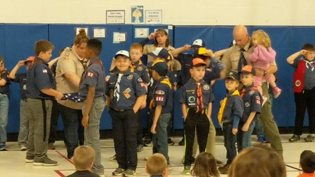 Members of Cub Scout Pack 382 present a new flag as part of a May 21 ceremony at Briar Glen Elementary School in Wheaton. Also at the ceremony, Ryan Ahern of Glen Ellyn, a retired U.S. Army Green Beret, was honored during the ceremony.