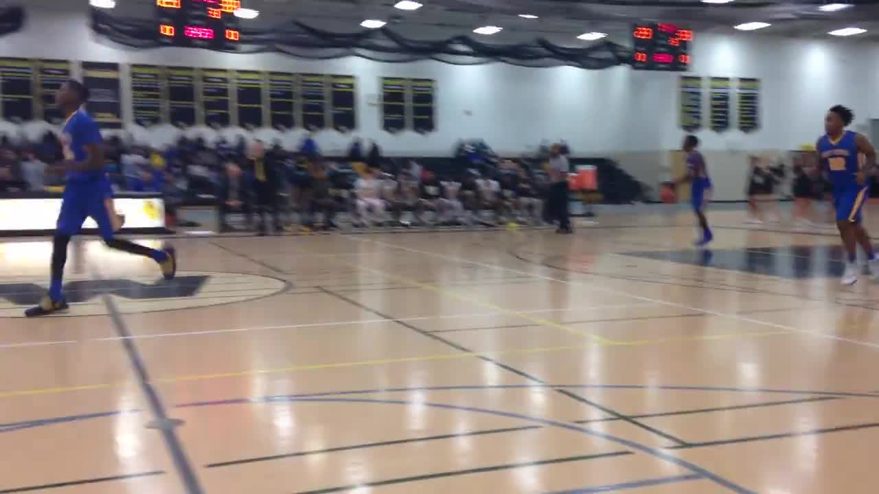Mike Smith hits a 3-pointer for West, and Don Joachim scores for Central on a move down the baseline.