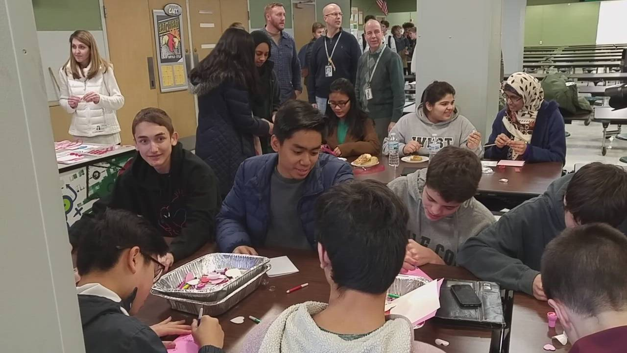 Glenbard West High School students on Feb. 1 create cards and letters to thank hospitalized veterans and those serving in the military.