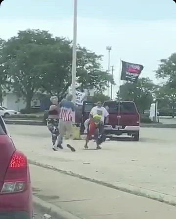 An altercation takes place between two protestors and another man on Monday (June 29) at the parking lot of 1801 West Jefferson St., Joliet. The two protestors Rhiannon and Gabriella Woods said Robert Tracy, a Joliet man who sells Trump signs, had attacked them after one of them tried to grab a flag on his truck for a selfie. Rhiannon Woods suffered a deep bruising on her arm after she said Tracy struck her with a flag pole. Tracy said he doesn't remember striking her with a flag pole. Joliet police said the incident is under investigation.