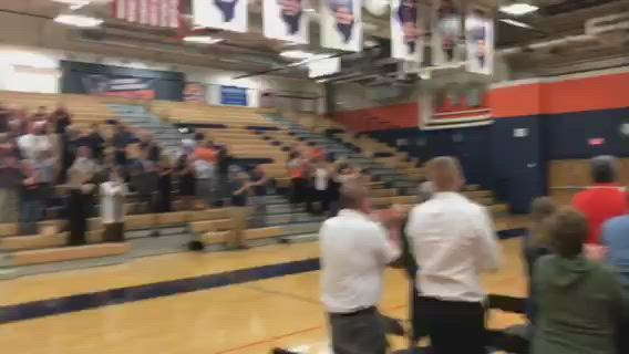 At the prompting of former Coach Karl Hoinkes, the guests at the memorial service for Ken Pickerill rose to give him a standing ovation.