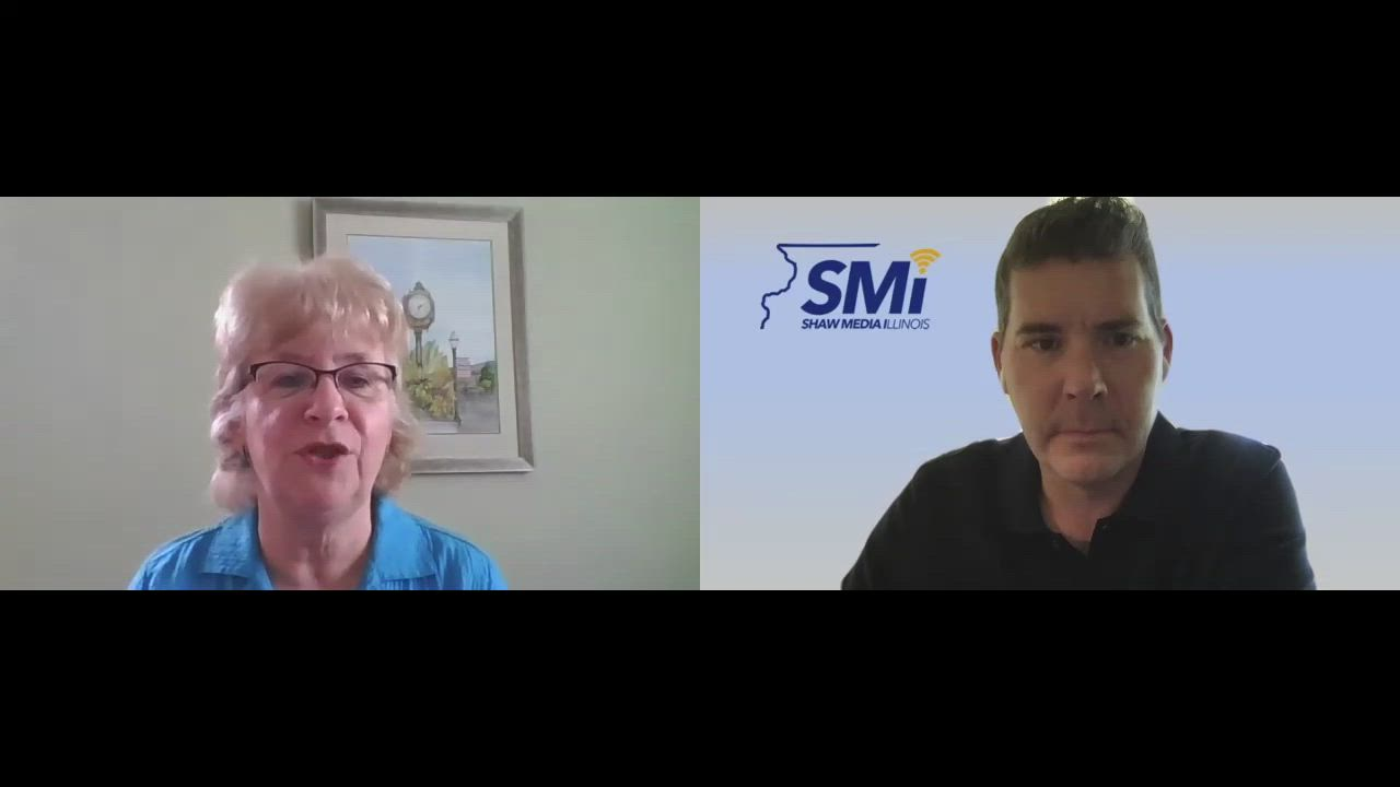 Diana Kenney of Downtown Crystal Lake talks with SMI's Tom Shaw
