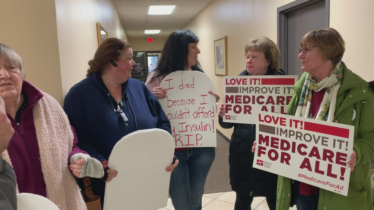 "A group of constituents conduct a ""die in"" at U.S. Rep. Bill Foster's Joliet office to pressure him to support Medicare for All and the Green New Deal."