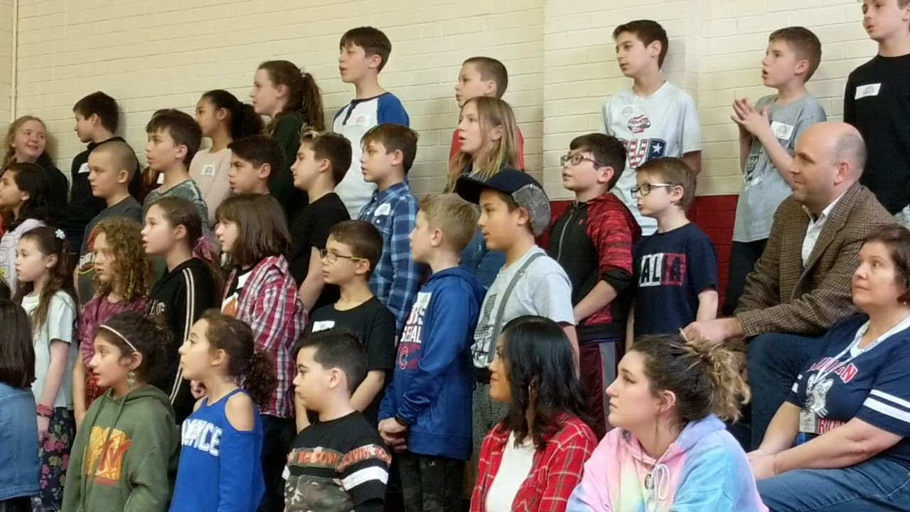 Students on March 21 help celebrate the 90th anniversary of Lincoln Elementary School in St. Charles.