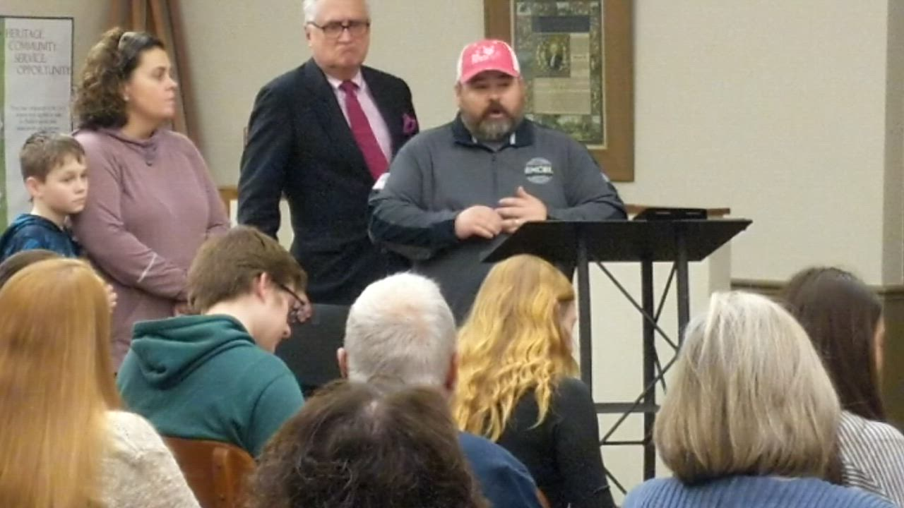 Minor and Jennifer Mobley talk at a Dec. 2 St. Charles City Council meeting about the efforts of Big Hearts of Fox Valley, which collects presents for needy St. Charles Dist. 303 families. St. Charles Mayor Ray Rogina declared the week of Dec. 8-14 as Big Hearts of Fox Valley week.
