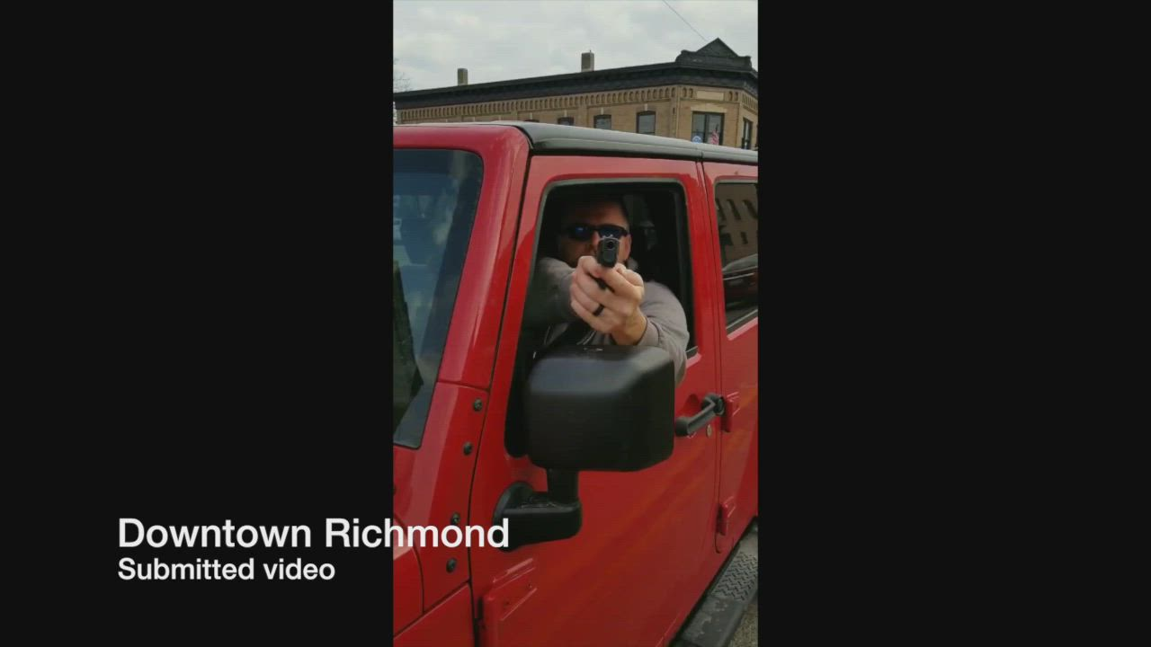 In this submitted video, a man draws a gun on a driver in downtown Richmond
