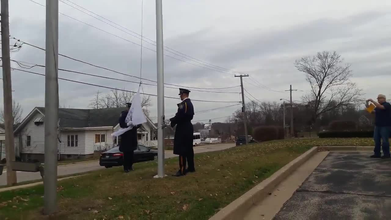 Two members of the Oswego Police Department Honor Guard helped raise a special flag celebrating the state's bicentennial, which is next year. However, the first attempt hit a snag as the rope snapped.