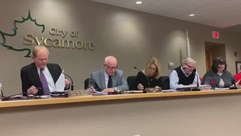"""Sycamore City Attorney Kevin Buick explains to Sycamore Mayor Curt Lang how to administer an """"omnibus"""" vote."""