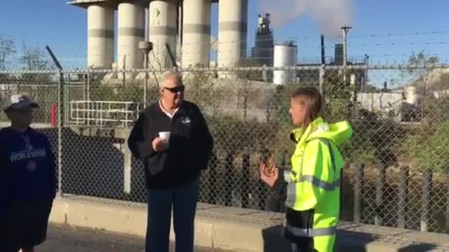 Sarah Hunn, Chief Project Engineer at DuPage County Stormwater, begins the tour of the Elmhurst Quarry Flood Control Facility by describing its purpose.