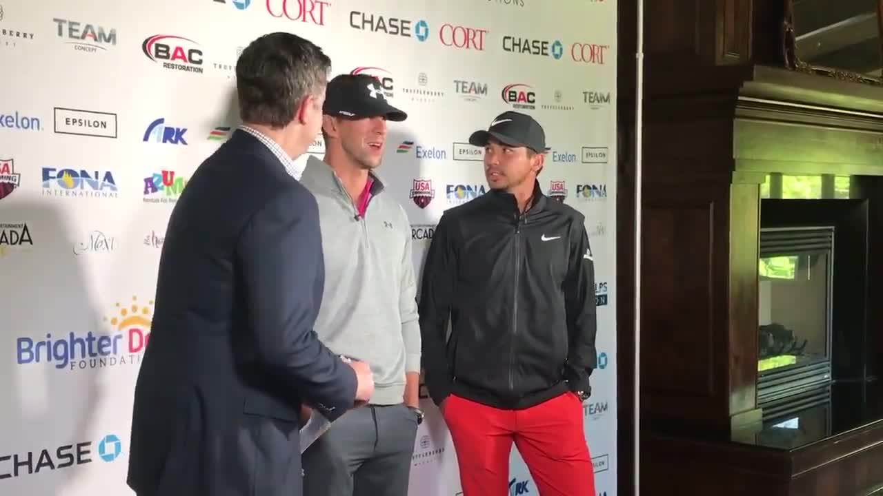 Michael Phelps and Jason Day meet with the press before the Golf Give Gala charity golf outing at the St. Charles Country Club