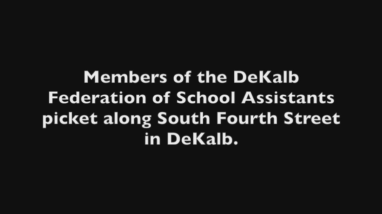 Members of the DeKalb Federation of School Assistants demonstrate their desire for a living wage along South Fourth Street.