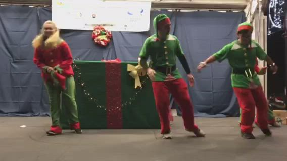 Elves took a moment to jam out before Oswego lit its Christmas tree Friday, Dec. 6.