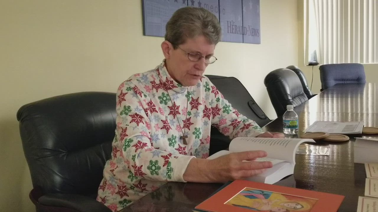 Kathy Ellinger reads one of her favorite religious poems.