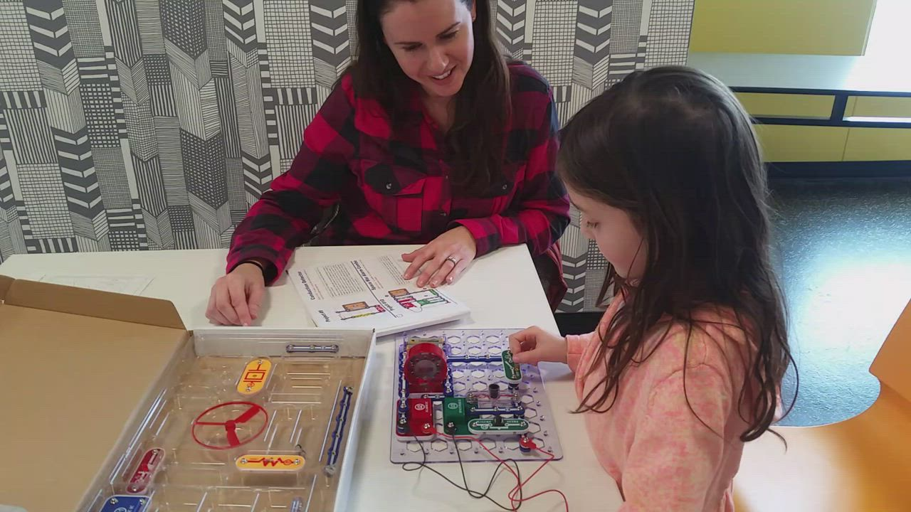 Children build snap circuits during the monthly free Mighty Makers event at the DeKalb Public Library.