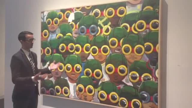 Elmhurst Art Museum executive director John McKinnon describes an FlyBoy art piece by Hebru Brantley.