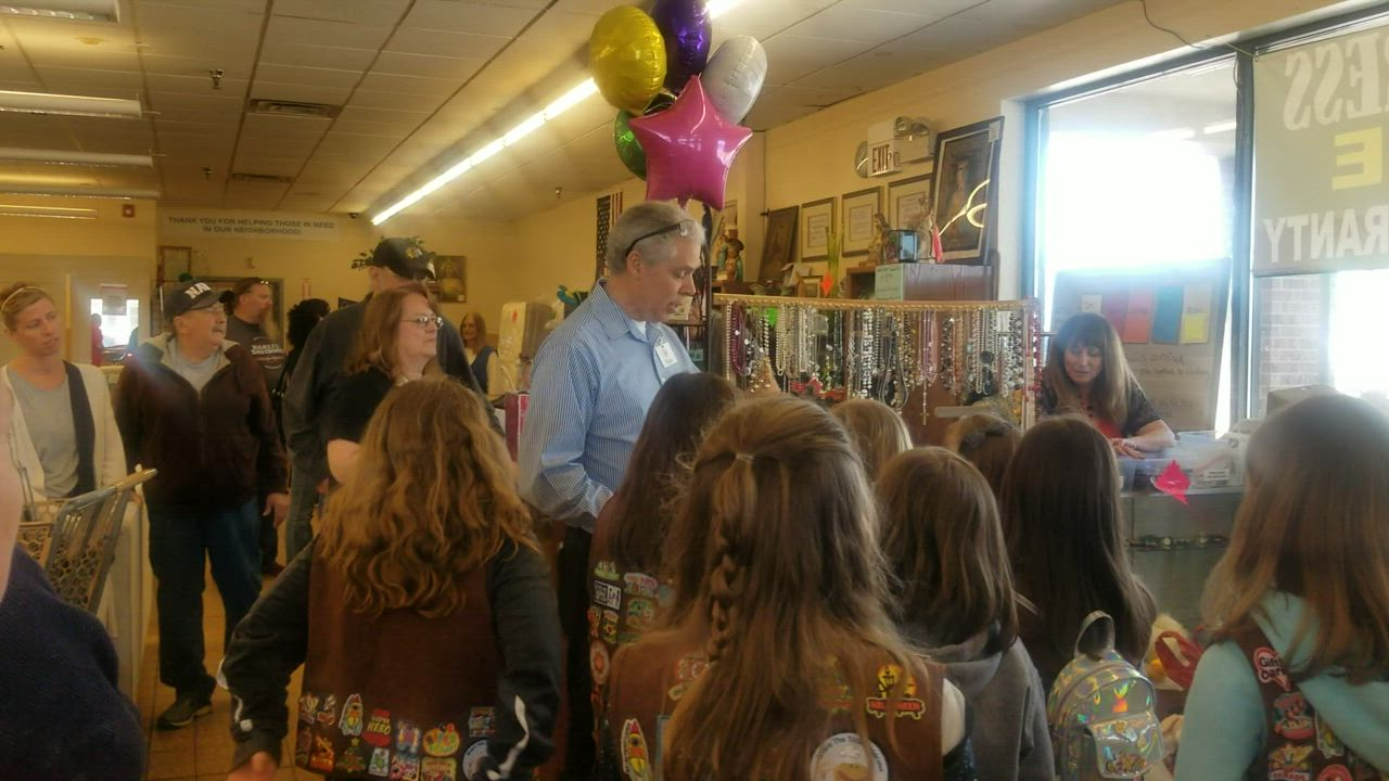 Ron Moore, store manager at a St. Vincent de Paul thrift store in Joliet, explains the store's mission to New Lenox Girl Scout Troop 75208