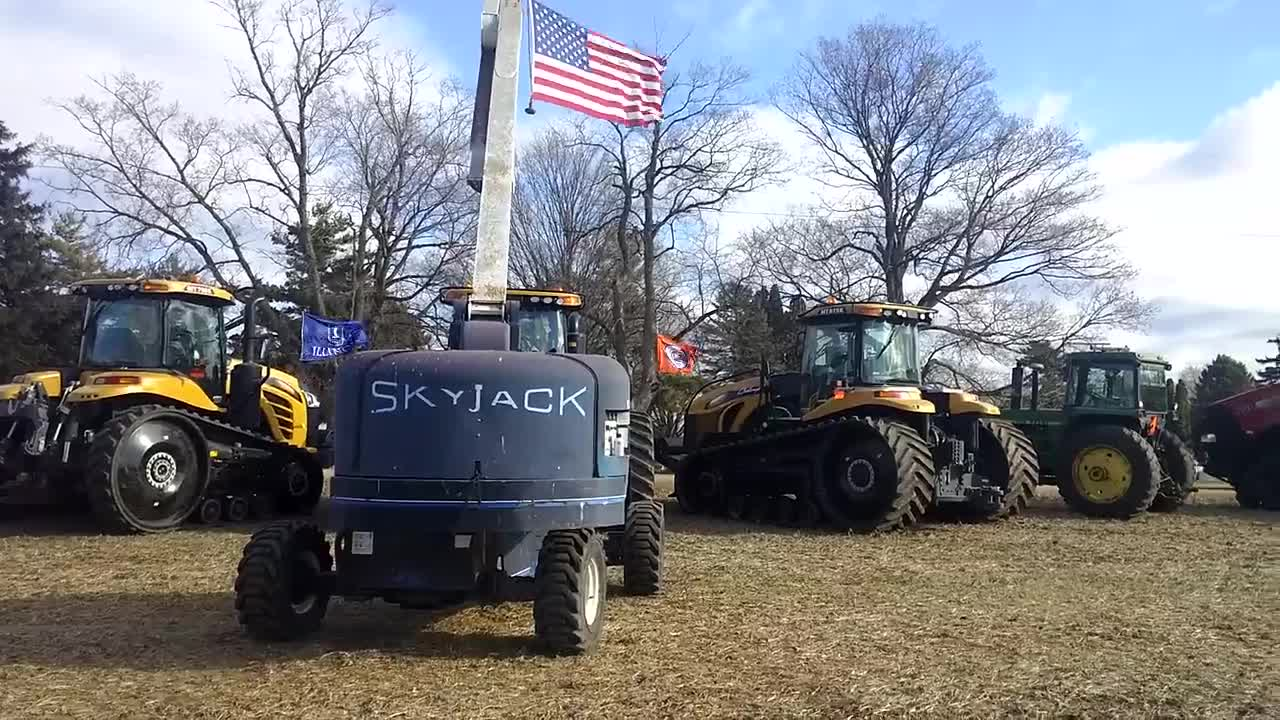 Area farmers lined up 51 tractors to honor Rory and Ryan Miller, the father and son who died Tuesday in an explosion after striking a natural gas line while laying tile, on Saturday, Dec. 9, 2017, in Amboy.