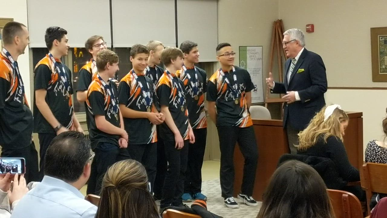 St. Charles Mayor Ray Rogina honors the St. Charles East High School Boys Bowling State Champions during the May 2 St. Charles City Council meeting.