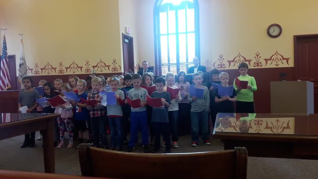 "Second grade students from Cross Lutheran School in Yorkville sang patriotic songs, including ""God Bless America,"" during a bicentennial state flag raising ceremony at the Kendall County Historic Courthouse in Yorkville on Dec. 4."