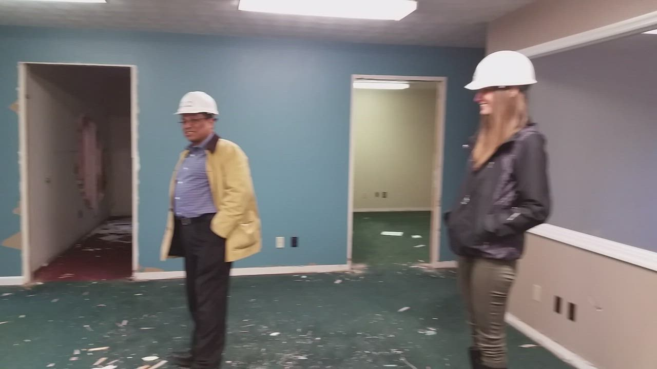 Administrators with Family Service Agency give a sneak peek at the agency's future home, which is twice the size of its current site.