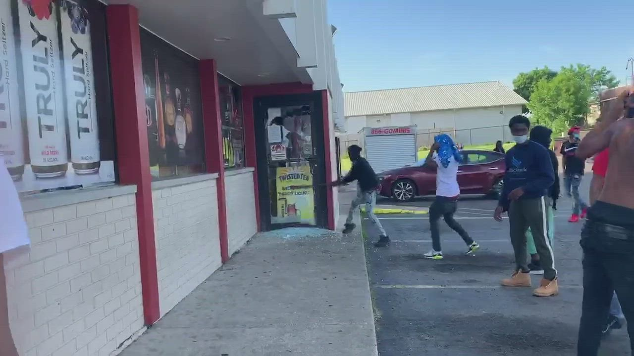 A group of people attempt to loot several businesses in DeKalb on Sunday, while another group stopped them from looting Rocky's, and Pastor Joe Mitchell asked the looters to disperse.