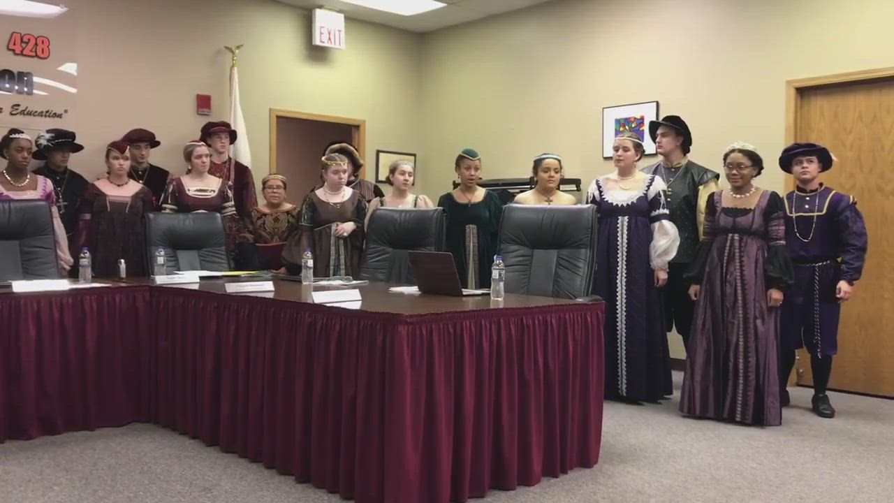 DeKalb High School Madrigal singers serenade the school board before their last meeting of the year Tuesday, Dec. 17