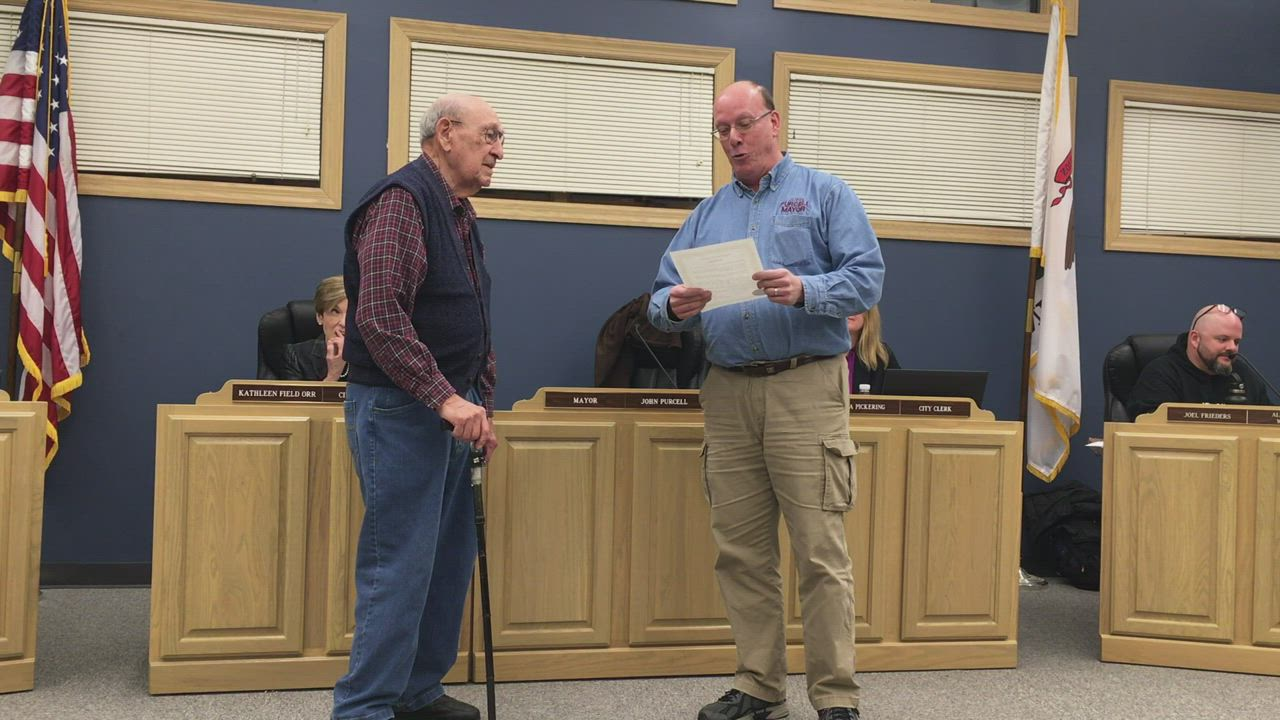 Yorkville Mayor John Purcell reads a proclamation commemorating Yorkville resident John Schneider, who celebrated his 100th birthday on Monday, Feb. 10, during the Tuesday, Feb. 11 City Council meeting at City Hall, 800 Game Farm Road in Yorkville.