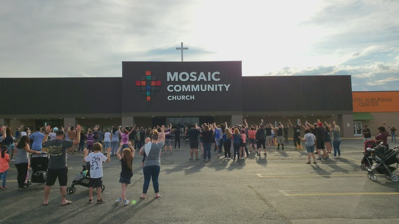 On Wednesday night, a crowd gathered in the parking lot at Mosaic Community Church in Joliet to united people in prayer