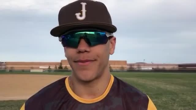 Vincent talks about the Golden Eagles' 5-4 victory over CL Central with his teammates jousting behind him.