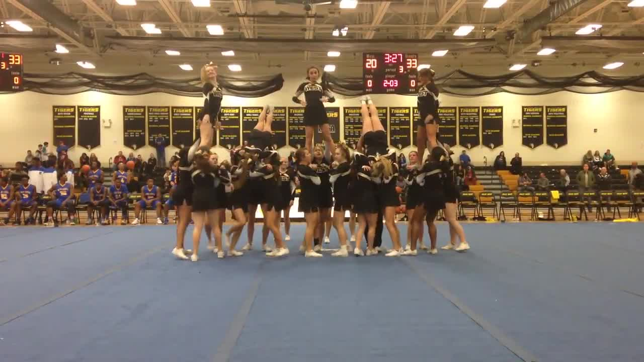 Joliet West's cheerleaders perform at halftime of game against Joliet Central