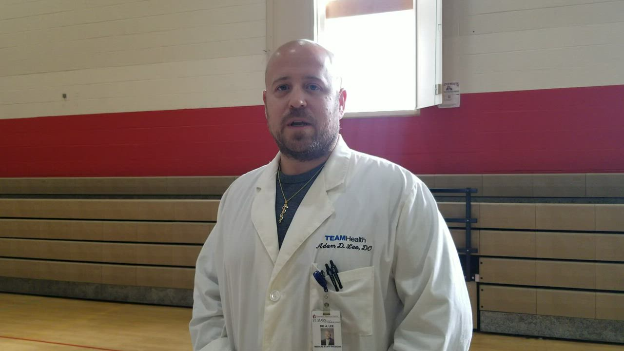 Dr. Adam Lee explained the activity he brought for students at St. Dennis Catholic School in Lockport on Nov. 5.