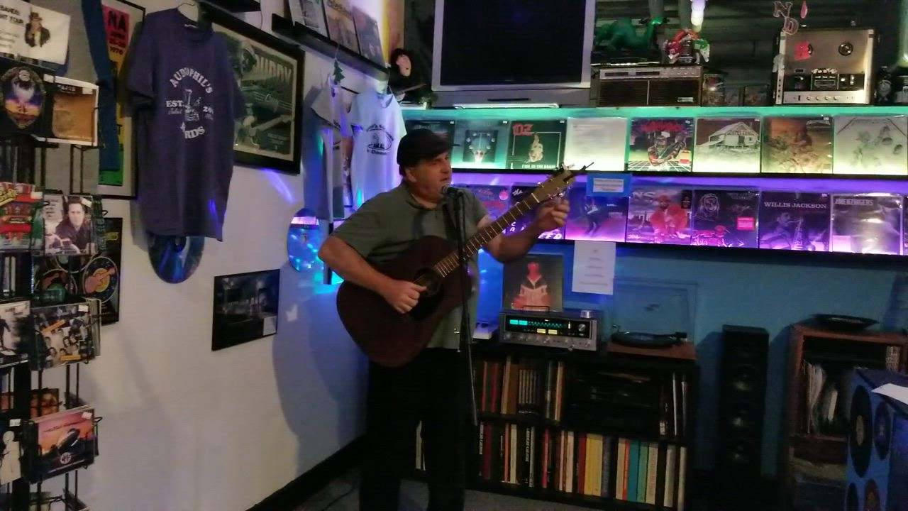 Ted Slowik performed an original song he wrote about Molly Zelko on Dec. 4 at Audiophil's in Joliet.