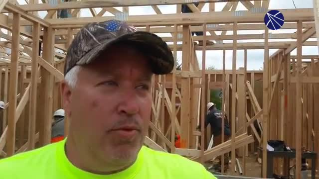 Manusos Contracting owner Joe McKeown of Johnsburg describes the A Soldier's Journey Home build project for veteran Tony Chobanov and his Family.