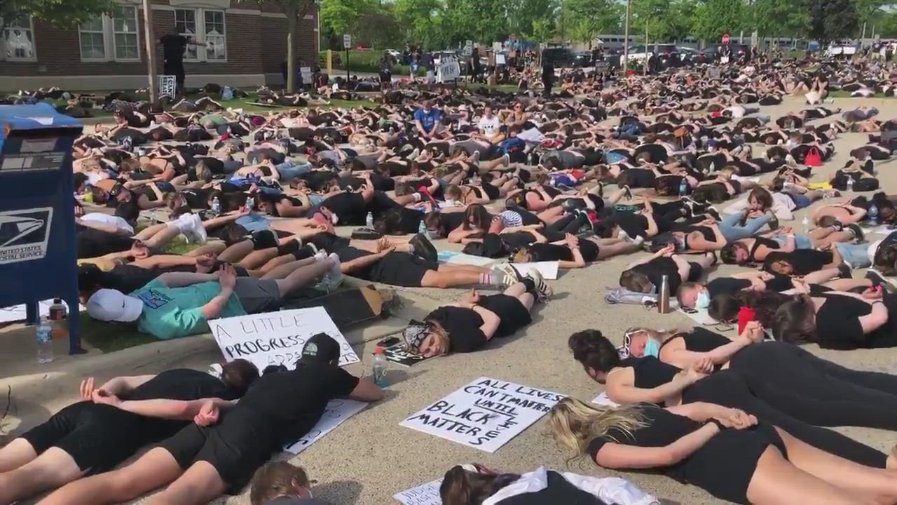 Hundreds lay down for 9 minutes of silent protest in the parking lot at the Crystal Lake City Hall/Police Dept at Wednesday's Black Lives Matter protest