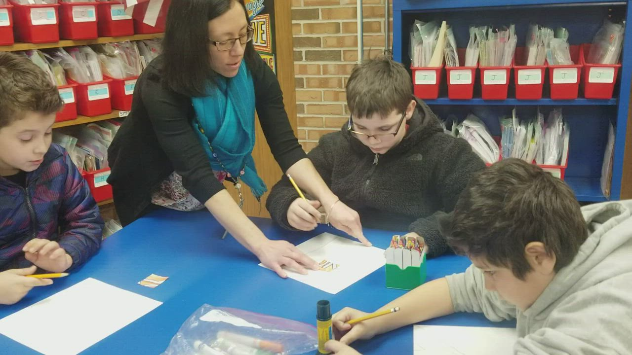 Fourth grade students at Thomas Jefferson Elementary School in Joliet create their portion of a mural.