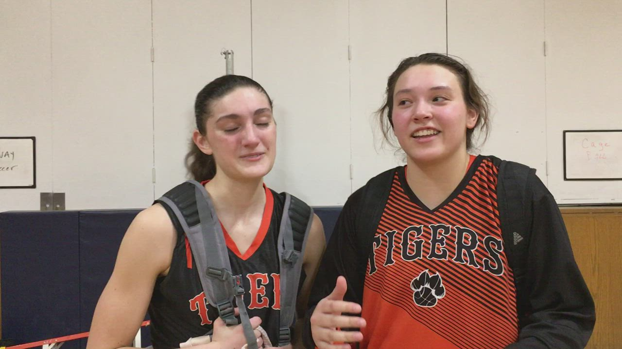 Cori Hamill and Maddie Haslow talk about the Tigers' 48-39 regional championship win against Dundee-Crown.