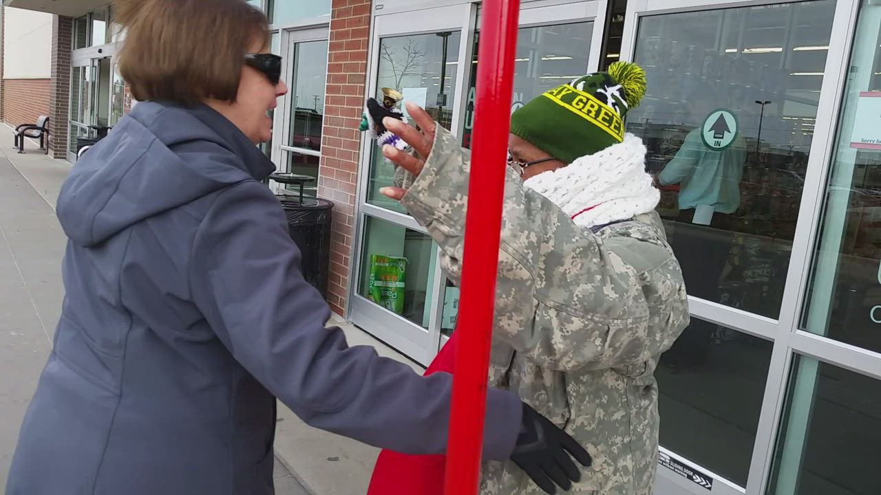 LaTonya Wilson, 54, of DeKalb, rings a bell for the Salvation Army outside Hy-Vee. Area residents donate and chat with her.