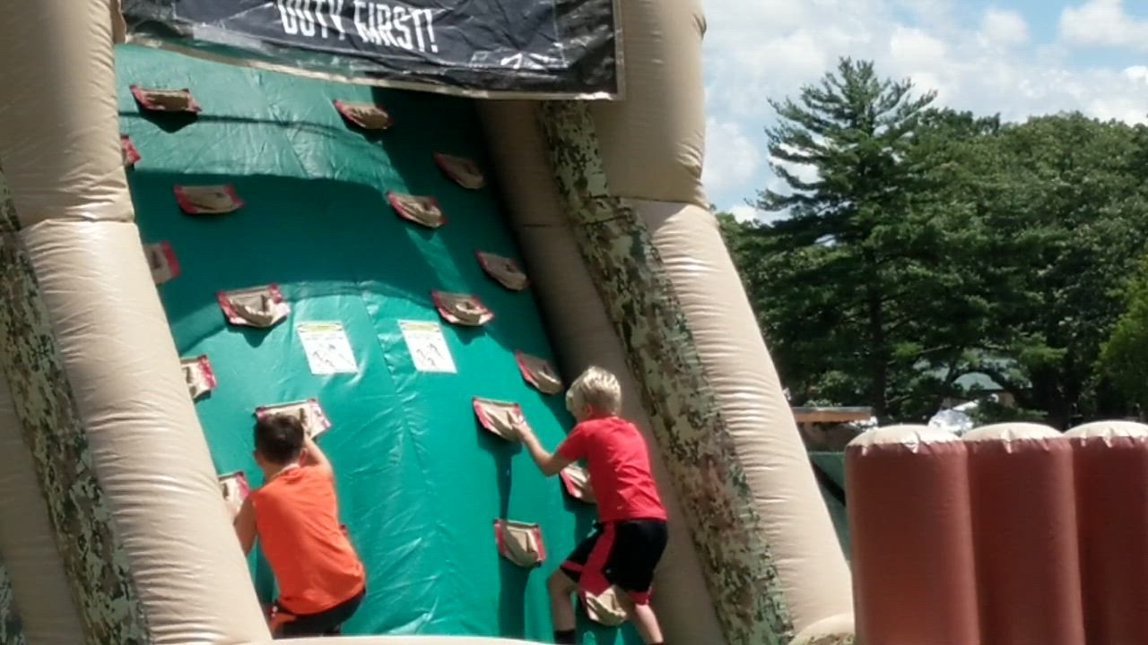 Kids participate in an obstacle course as part of McCormick Day on July 26 at Cantigny Park in Wheaton.