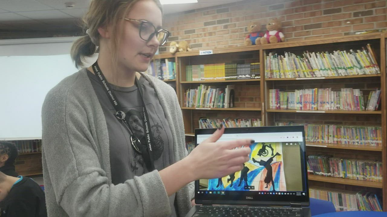 Angela Klunder, art teacher at Thomas Jefferson Elementary School in Joliet, explains the design concept of the mural the fourth grade students are creating.